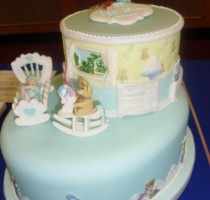 R8 2013 Silver and trophy 2 tier Christening Cake Kathryn Quttaineh Runnymede