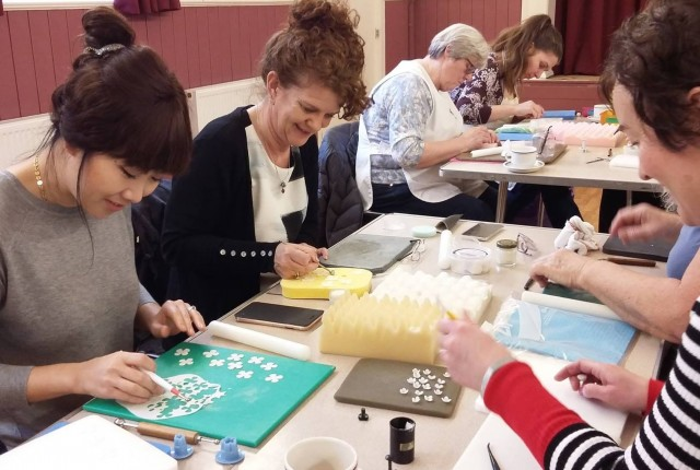 Members of The British Sugarcraft Guild at one of the many workshops held across the UK, working on the decorative pieces for the new replica cake.