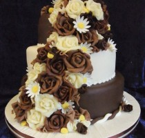 Chocolate - R8 Carolyn Harvey Tunbridge Wells Branch Chocolate roses </br>and sugar daisies Chocolate top and bottom and celebration colour centre