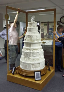 Carefully assembling the display case around the cake