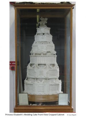 replica full-sized cake in cabinet